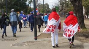 Sydney supporters heading to the Melbourne Cricket Ground for the AFL Grand Final