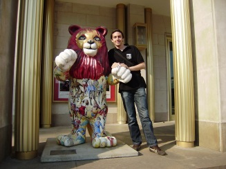 Posing next to a lion in Dresden in Germany (or maybe Leipzig, I'm not sure anymore)